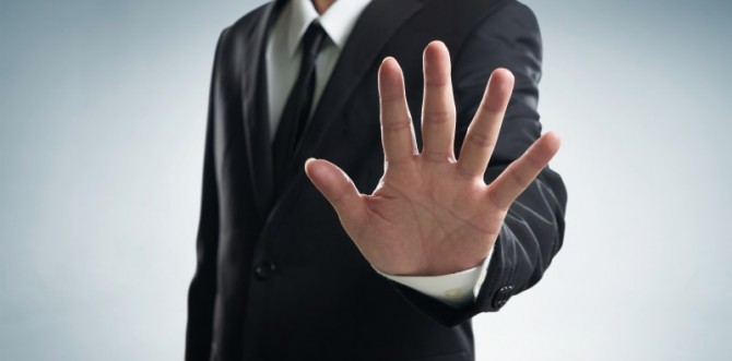 s_graphicstock-hand-stop-shown-by-businessman_S_98Uivgie